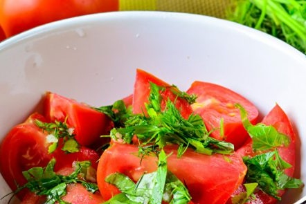 In a bowl, tomatoes and greens