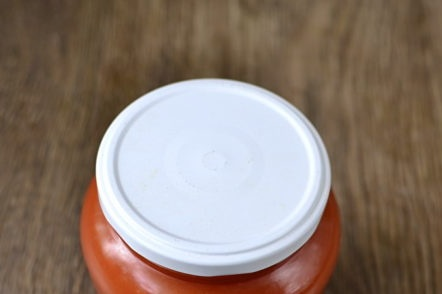 ketchup of plums and tomatoes in a jar