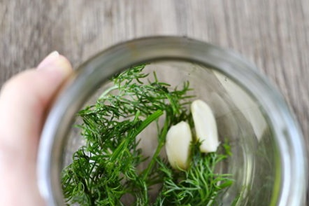 put in a jar of herbs and garlic