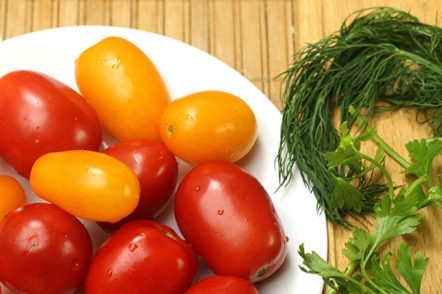cooking tomatoes and greens