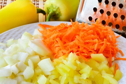 chop onions, peppers and carrots