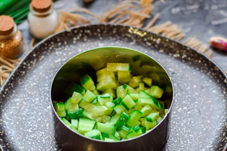 a layer of cucumbers